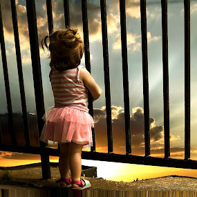 Looking Through The Rails by Sandra Hilton Wagner - Babies & Children Toddlers ( clouds, backlit, overlook, sky, girl, guard rail, toddler, #GARYFONGDRAMATICLIGHT, #WTFBOBDAVIS,  )