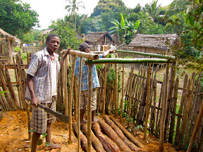 You can see how we laid the logs over the pit to provide the foundation, and you can see some other guys helped us with the wood and bamboo frame for the pit toilet.