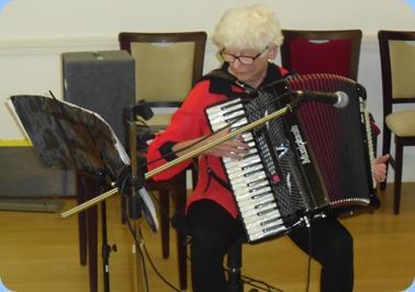 Barbara Olds playing her midi-accordion.
