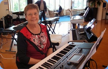 Pam Rea preparing to play her Korg Pa900. Photo courtesy of Dennis Lyons.