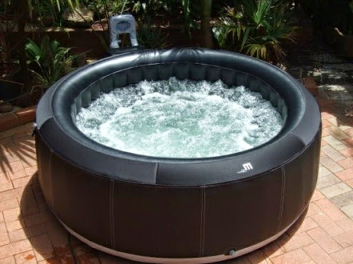 super-small-black-portable-hot-tub-in-the-garden