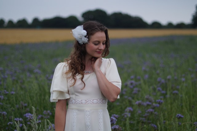 seventies inspired bride in a purple field