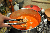 Add the meatballs to the sauce, gently because they are still fragile.