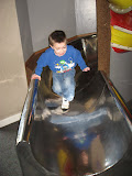 Bryan sliding down a slide at the Magic House in St Louis 03202011a