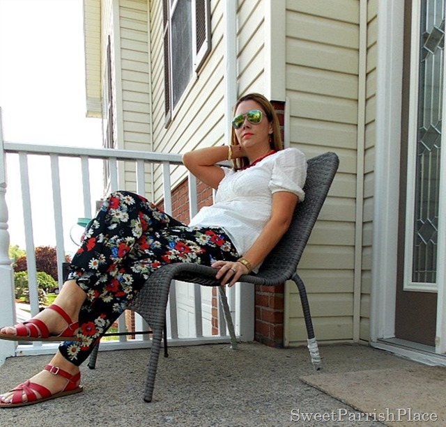 Floral palazzo pants, cream blouse, red salt water sandals1