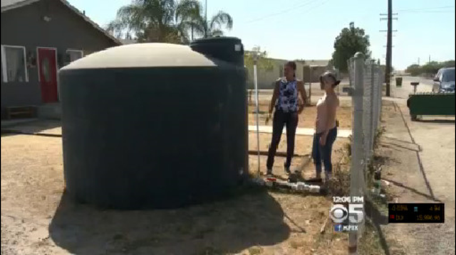 The 2000-gallon water tank outside Myra Marquez's home in Okieville, Tulare County, California. She checks the gauge on her 2500 gallon water tank before she touches a faucet. The tank gets filled every Monday. Rationing 2000 gallons over five or six days is tough. Photo: CBS