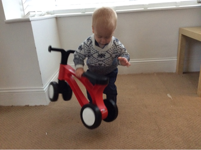 Alexander lifting the ultra-lightweight Toddlebike2 pre-balance bike
