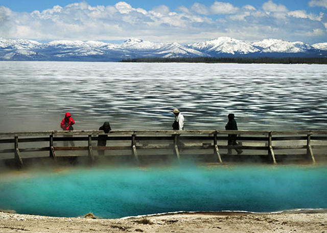 A hot spring and partially frozen Yellowstone Lake in Yellowstone National Park in Wyoming in June 2011. Under a new Wyoming law, a photo like this could now be illegal. Photo: Mark Ralston / AFP / Getty Images