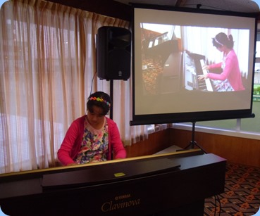 Hana Tani playing the Clavinova CVP-509. What a wonderful budding pianist! Photo courtesy of Laurie Conder.