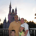 The Freys in front of Cinderella's castle at nite in the Magic Kingdom in Disney 06052011