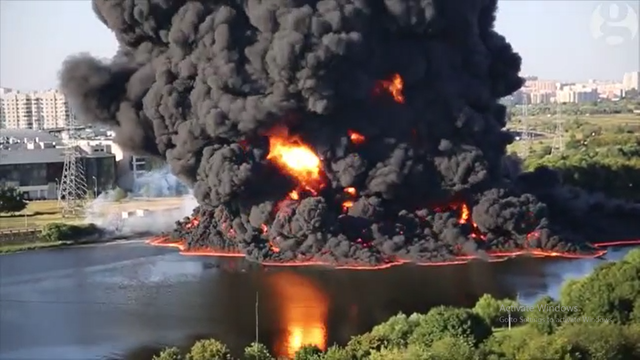 Amateur footage shows a large oil fire on the surface of the Moscow river after an underwater pipeline reportedly burst on 14 August 2015. The Moscow oil refinery, owned by Gazprom Neft, told Reuters it was unaffected by the fire, and did not own the pipeline where the incident occurred. Local news agencies reported that one child and two adults suffered burns from the incident. Photo: Viral Hog / The Guardian