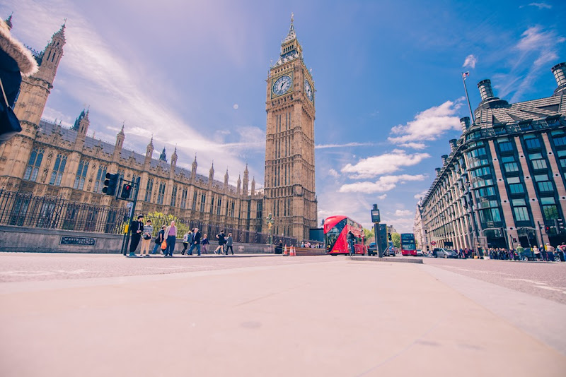 Big Ben On A Summers Day With Blue Sky And Red Bus