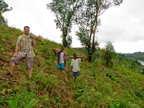Me and the guys who were helping (really doing all the work!) carrying some logs back to the village to use for our pit toilet.