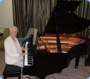 Dorothy Waddel playing the Yamaha mini-grand piano.