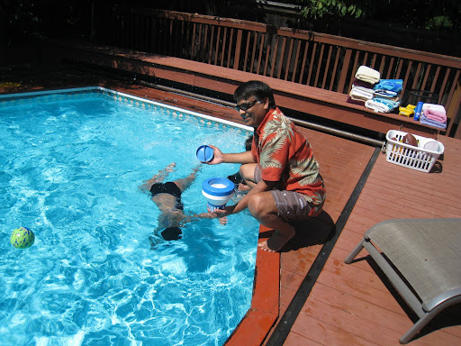 Adding chlorine tablets to clean the pool
