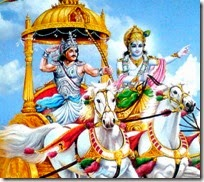 [Krishna and Arjuna on chariot]