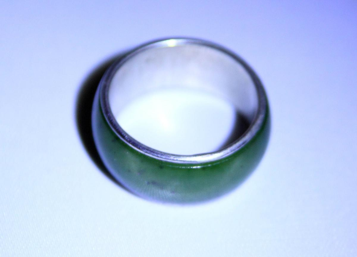 Broad ring with green stone