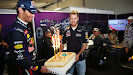 Mark Webber (AUS) and Sebastian Vettel (GER/ Red Bull Racing) bring out a cake for their Team Principal Christian Horner as he celebrates his 40th birthday