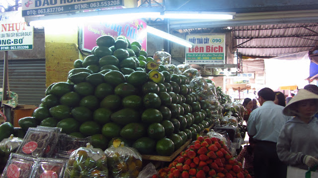 A mountain of avocados at the local market.