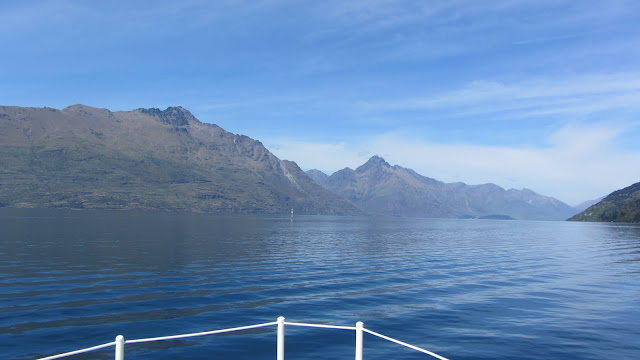Cruising beautiful Lake Wakatipu around Queenstown's million dollar homes.