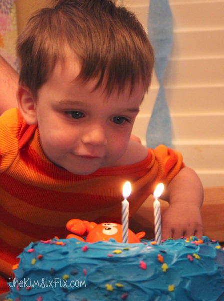 Baby blowing out birthday candles