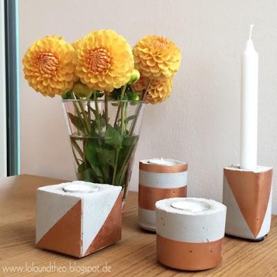 Kerzenhalter aus Beton und Blumenvase mit Dahlien