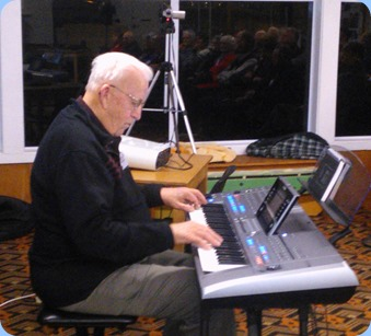 Peter Herrick playing his Yamaha Tyros 5.