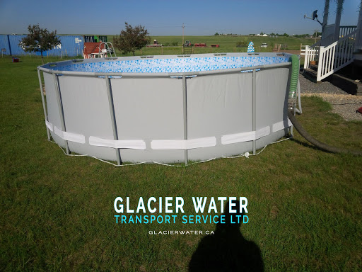This above ground swimming pool was filled with clean, potable water and ready for a (slightly chilly) swim in less than half an hour. From www.glacierwater.ca — at MD of Foothills No. 31.