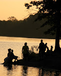 Gathering by the lake at sunset.