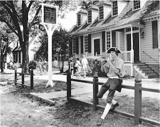 Sergeant Blair Miller, of the Colonial Williamsburg Senior Fife and Drum Corps, strolls through the streets of the historic area and plays colonial tunes on his tin whistle for the summer visitors. (CWF photo - August 1977)