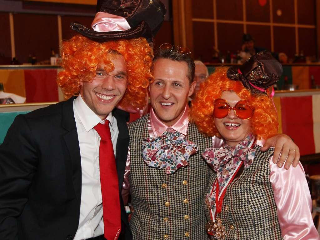 Михаэль Шумахер со своей женой Коринной на карнавальной вечеринке в Кельне