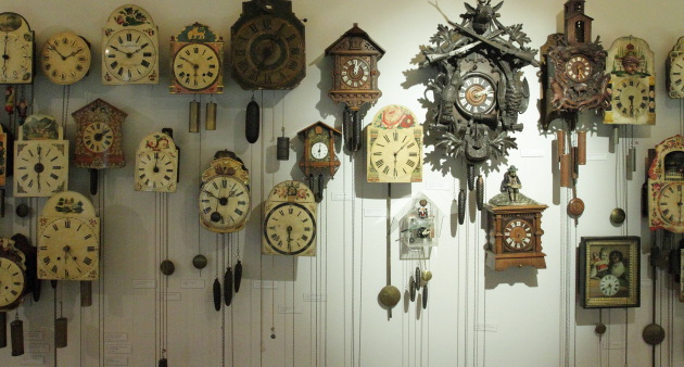 Collection of ancient cuckoo and musical clocks at Black Forest Museum, Triberg, Germany