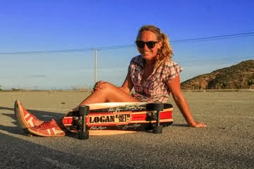Baja's Marianne Koopman is all smiles and taking a break after trying out her new board on 12/13.