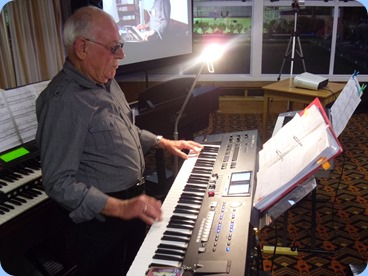 Club Treasurer, Laurie Conder, playing his lovely Roland keyboard.