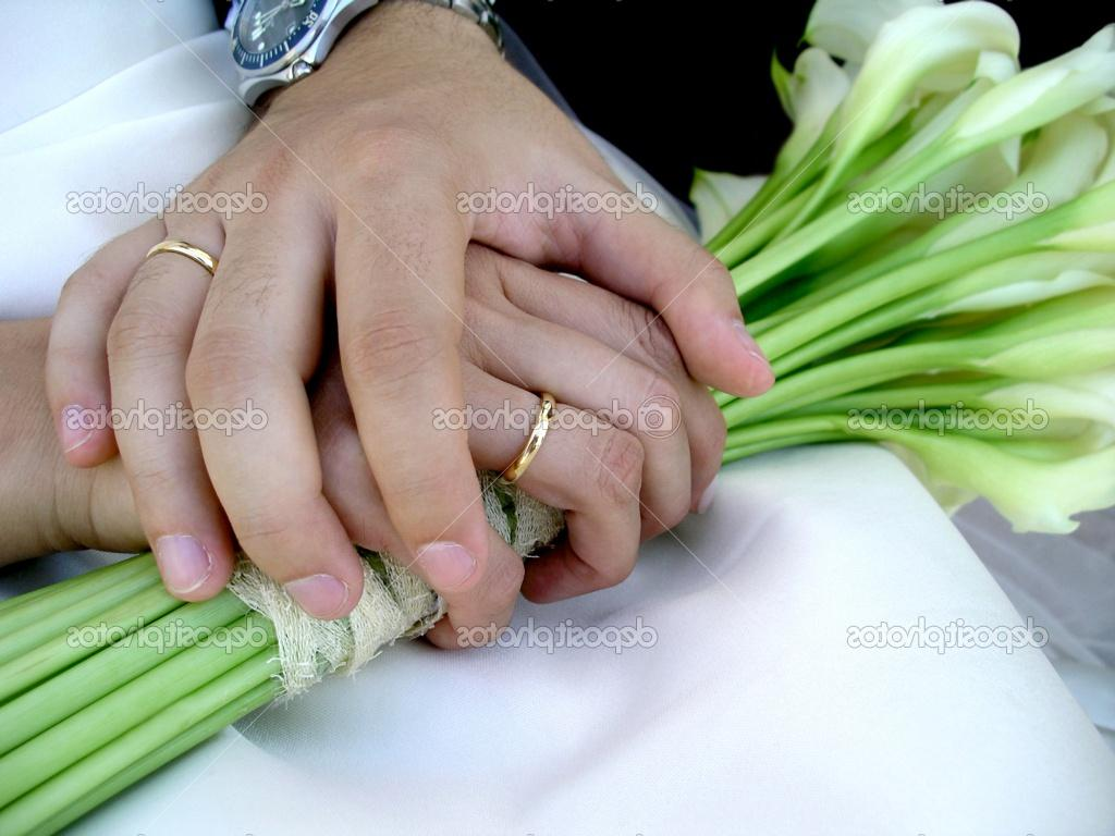 holding hands with wedding