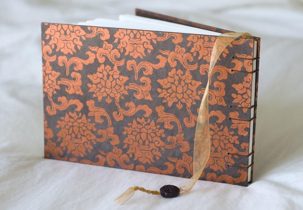 guest book orange brown