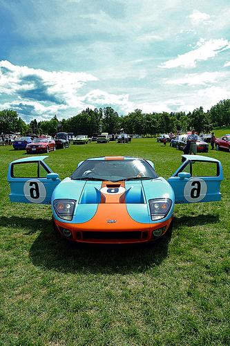 Gulf coloured Ford GT  6. At the time these people were preparing to leave,