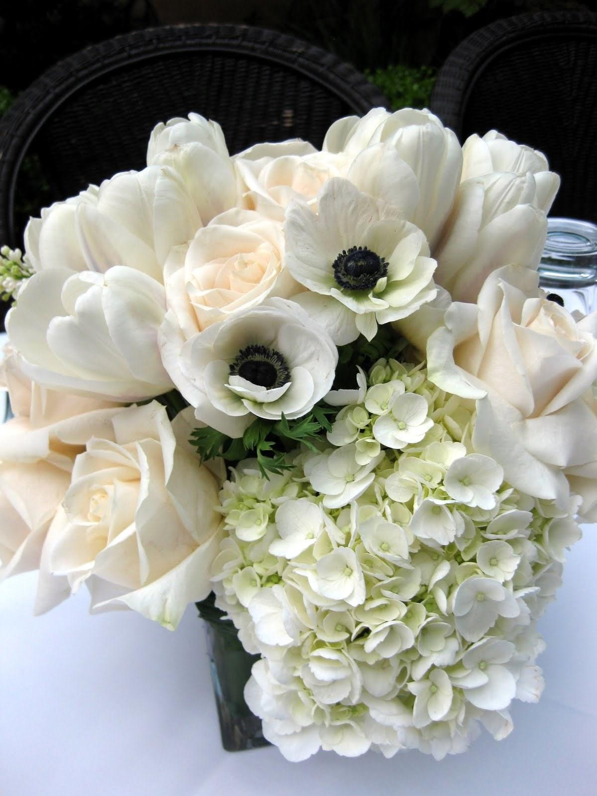 it was the centerpieces! Look! Cream and ivory, square vase,
