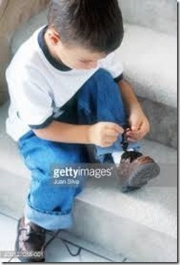 200127058-001-boy-sitting-on-staircase-trying-to-tie-gettyimages