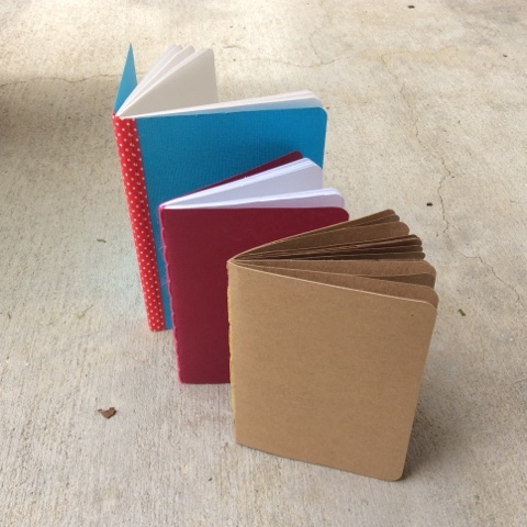 two sizes of DIY handmade saddle stitched notebooks