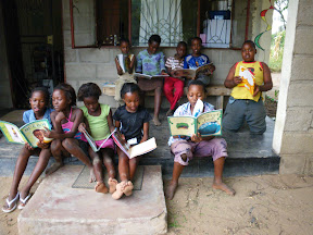 Here's a bunch of kids (neighbors and host family) reading books at our house. Lora's work is really starting to catch on!