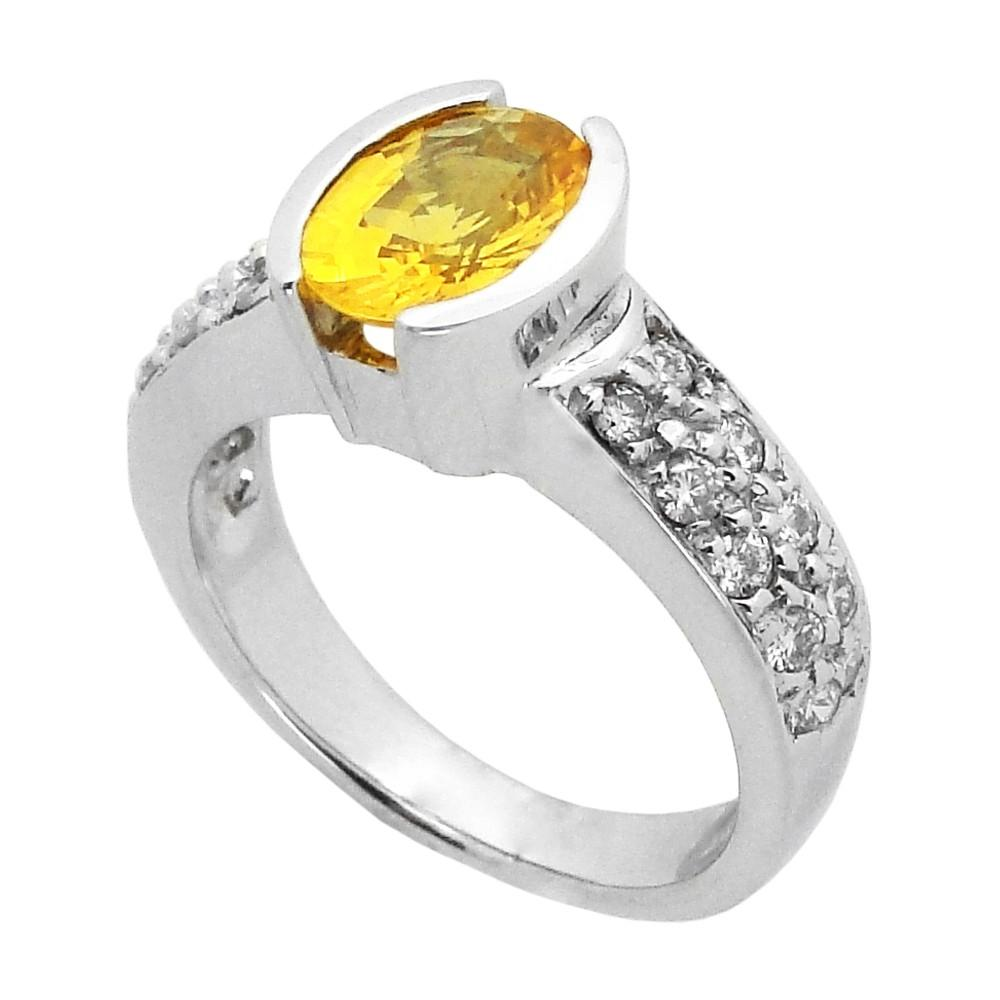 W?th ?n oval yellow sapphire