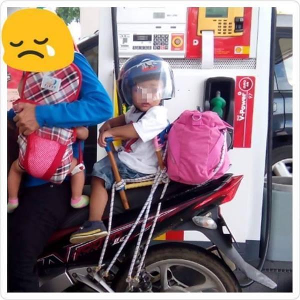 wanita dan anak naik motor dari penang ke kajang.jpg