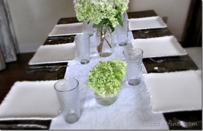 Summer Farmhouse Tablescape Idea using a simple flower arrangement and white dishes