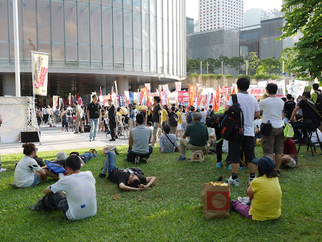 people siting in a grassy area