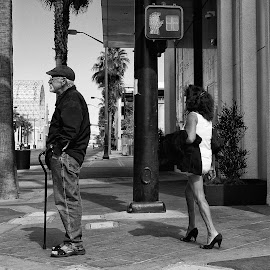 Man with cane and lady of the day by Michael Velardo - People Street & Candids ( las vegas, man woman, lady of the day, oldest profession, black & white, street lamp )