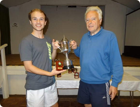 Mens Singles winner Oliver Cox receives the trophy from  Bill Heath - WJTC Chairman