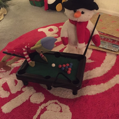 elf on the shelf playing snooker