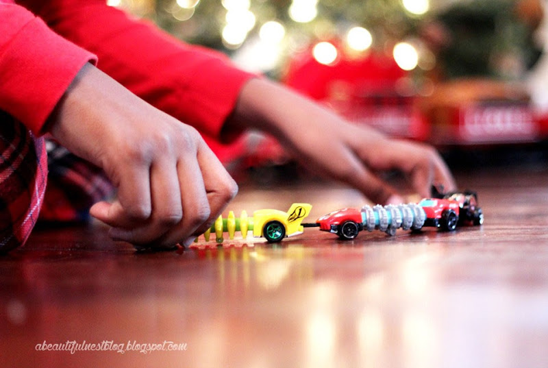 A-Beautiful-Nest-Christmas-2014-playing-with-cars