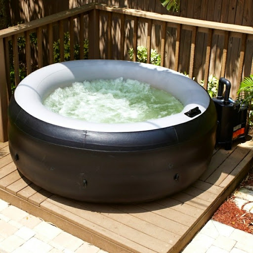 small-round-portable-hot-tub-outside-in-the-corner